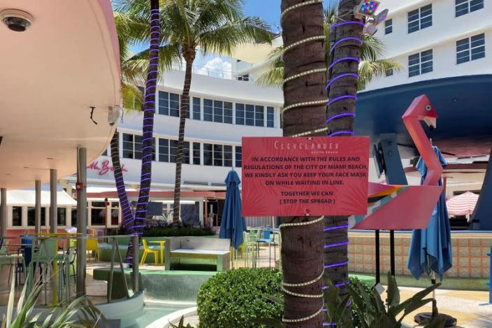 A sign warning guests about coronavirus disease is seen at the Clevelander South Beach Hotel and Bar in Miami Beach
