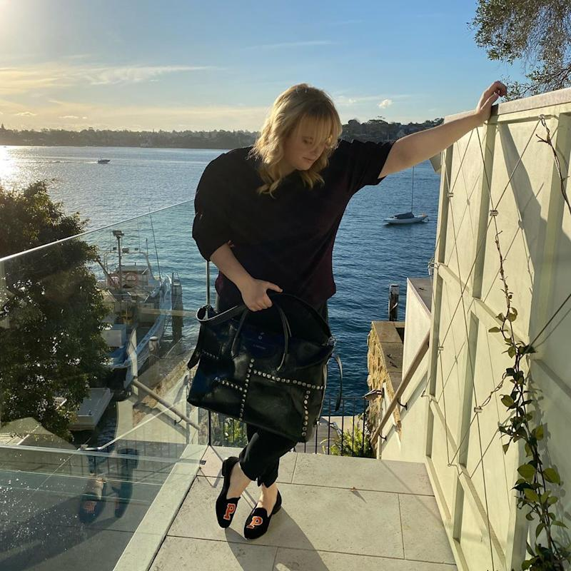 Rebel Wilson poses in front of Sydney harbour