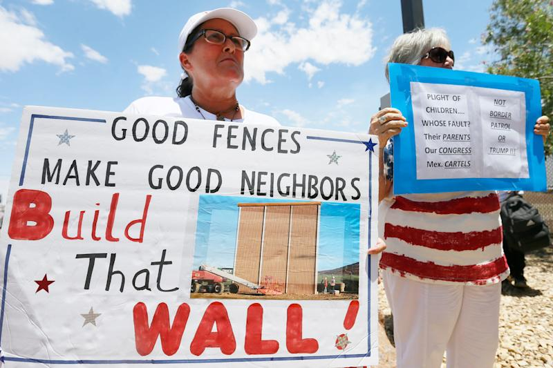 Melanie Brooks and Diane Otten hold signs outside the Clint Border Patrol station Monday, July 1, at the station in Clint. Protesters gathered to hear U.S. and Texas lawmakers talk about what they thought of the area facilities they toured.