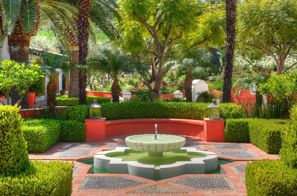 <p>The bright Moorish gardens reflect the colors and designs of the interior. (Photo by Steve Brown/Sepia Productions)</p>