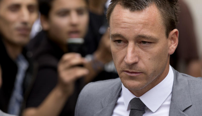 Former England soccer captain and Chelsea player John Terry leaves after being found not guilty at Westminster Magistrates Courts in London, Friday, July 13, 2012. Chelsea captain John Terry was cleared Friday of racially abusing an opponent, Queens Park Rangers player Anton Ferdinand, during a Premier League match after one of the most high-profile trials involving a soccer player. The case led to Terry being stripped of the England captaincy by the Football Association ahead of the European Championship and the departure of coach Fabio Capello who disagreed with the decision. (AP Photo/Matt Dunham)