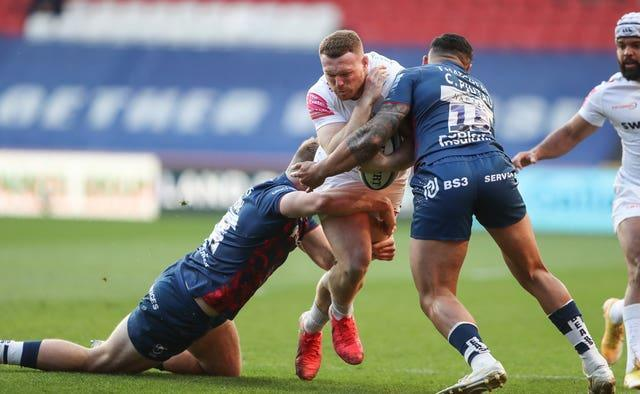 Exeter Chiefs' Sam Simmonds (centre) is tackled by Bristol Bears' Sam Bedlow and Charles Piutau during his side's 20-12 win over the Gallagher Premiership leaders