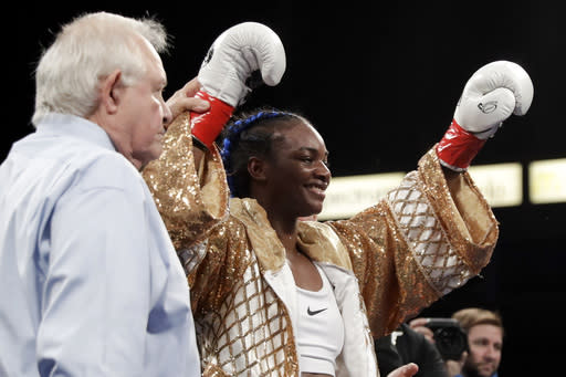 Claressa Shields celebrates her win against Belgium's Femke Hermans during their WBC/IBF/WBA middleweight title boxing match, Saturday, Dec. 8, 2018, in Carson, Calif. (AP Photo/Chris Carlson)