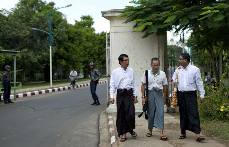 In this picture taken on Wednesday, Nov. 14, 2012, student leaders of a successive uprising, from left, Zaw Zaw Min, Hla Shwe, and Ragu Ne Myint walk outside the main gate of the University of Yangon, where President Barack Obama is scheduled to deliver a speech on Monday, Nov. 19, 2012, in Yangon, Myanmar. Since colonial times, the fight for change in Myanmar has begun on this leafy campus. It was a center of the struggle for independence against Britain and served as a launching point for pro-democracy protests in 1962, 1974, 1988 and 1996. For many, the school has today become a symbol of the country's ruined education system and a monument to a half century of misrule. (AP Photo/Gemunu Amarasinghe)