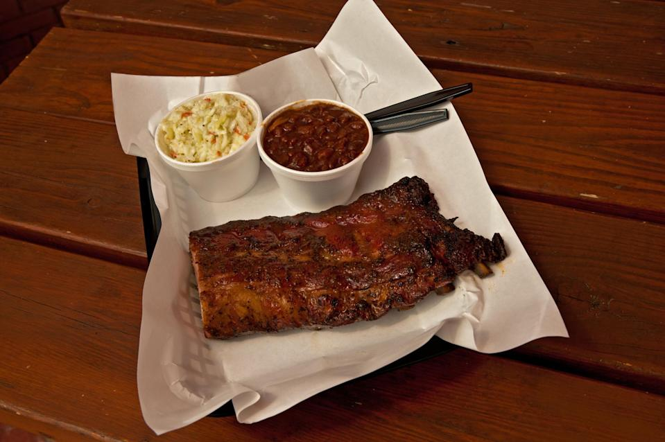 """<p>As a barbecue town, St. Louis is best known for its sauce, which is thick and sweet; and its <a href=""""https://www.thedailymeal.com/recipes/sticky-spare-ribs-recipe?referrer=yahoo&category=beauty_food&include_utm=1&utm_medium=referral&utm_source=yahoo&utm_campaign=feed"""" rel=""""nofollow noopener"""" target=""""_blank"""" data-ylk=""""slk:spareribs"""" class=""""link rapid-noclick-resp"""">spareribs</a>, which are cut """"St. Louis style,"""" in which a strip of meat and cartilage near the sternum is trimmed away and the whole rack is cleaned up so it looks neat and tidy. Less popular pork cuts, including rib tips, pork snoots and pork steaks (slices of shoulder grilled and stewed in sauce) can also be found here. Pair your St. Louis-style ribs with your favorite <a href=""""https://www.thedailymeal.com/cook/best-salads-without-lettuce-slideshow?referrer=yahoo&category=beauty_food&include_utm=1&utm_medium=referral&utm_source=yahoo&utm_campaign=feed"""" rel=""""nofollow noopener"""" target=""""_blank"""" data-ylk=""""slk:lettuce-free salad"""" class=""""link rapid-noclick-resp"""">lettuce-free salad</a>. Quintessential St. Louis barbecue spots include Bogart's and Pappy's.</p>"""