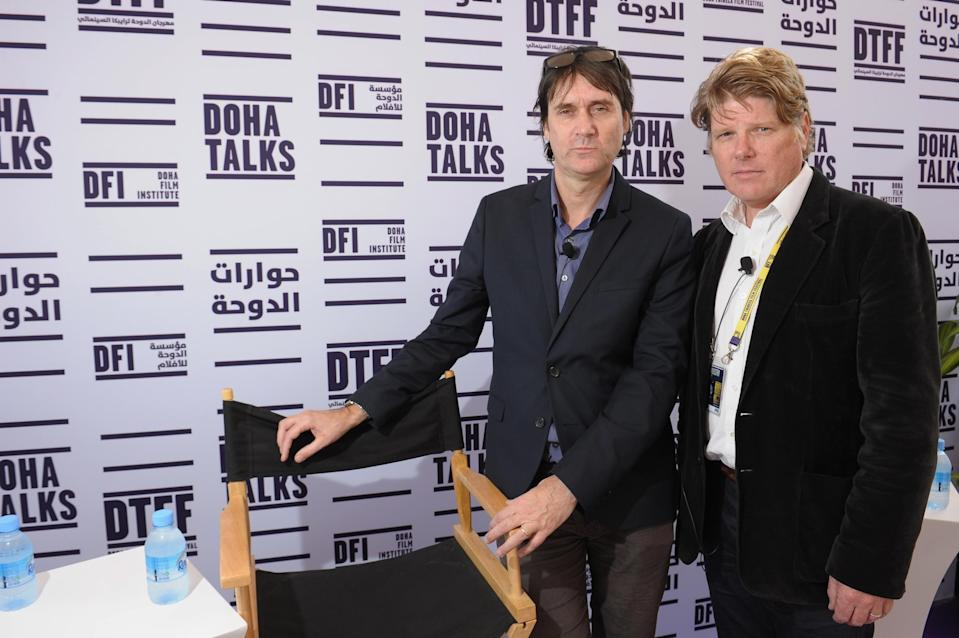 "Neal Purvis (L) and Robert Wade speak at the ""Masterclass with Neal Purvis and Robert Wade"" panel at the Al Mirqab Hotel during the 2012 Doha Tribeca Film Festival on November 19, 2012 in Doha, Qatar. (Photo by Michael Loccisano/Getty Images for Doha Film Institute)"