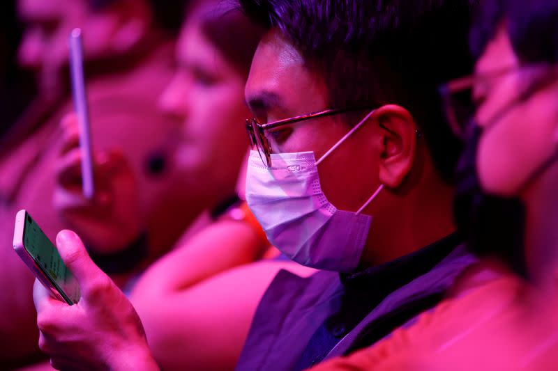 FILE PHOTO: An attendee wears a surgical mask during Samsung Galaxy Unpacked 2020 in San Francisco