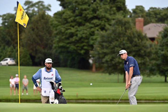 J.T. Poston hits onto the green during the sixth playoff hole after the final round of the Barbasol Championship golf tournament at Keene Trace in Nicholasville, Ky., Sunday, July 18, 2021. (AP Photo/Timothy D. Easley)