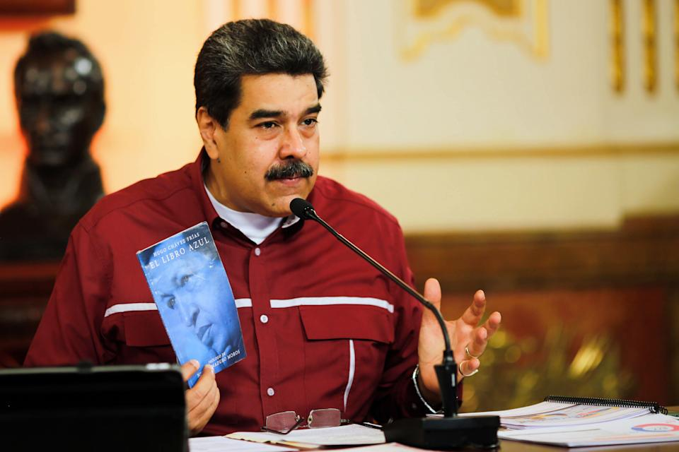 Handout picture released by the Venezuelan Presidency showing Venezuela's President Nicolas Maduro speaking during a televised announcement, at the Miraflores Presidential Palace in Caracas on October 20, 2020. - Maduro announced that Venezuela start a mass vaccination against the Covid-19 coronavirus between December and January, with vaccines from Russia and China. (Photo by JHONN ZERPA / AFP) (Photo by JHONN ZERPA/AFP via Getty Images)