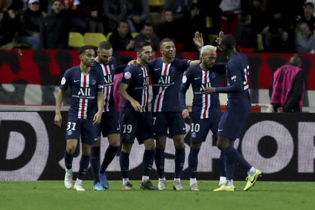 PSG's Kylian Mbappe, center, celebrates with teammates after scoring his side's fourth goal during the French League One soccer match between Monaco and Paris Saint-Germain at the Louis II stadium in Monaco, Wednesday, Jan. 15, 2019. (AP Photo/Daniel Cole)