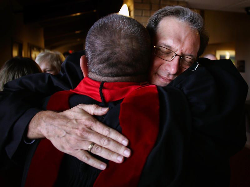 The Rev. Scott Anderson, facing camera, is greeted following his ordination ceremony in Madison, Wis. on Saturday, Oct. 8, 2011.  Anderson became the first openly gay person to be ordained to the ministry of the Presbyterian Church (USA), the largest Presbyterian denomination.  (AP Photo/Wisconsin State Journal/Craig Schreiner)