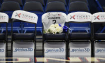A seat with a jersey and flowers is reserved in memory of Gianna Bryant before an exhibition basketball game in the first half of a basketball game against the US, Monday, Jan. 27, 2020, in Hartford, Conn. Bryant was going to play at Connecticut and head to the WNBA. That was the plan. Her promising life came to a shocking, sudden and sad end Sunday, Jan. 26, 2020 along with her father Kobe. They died in a helicopter crash in California along with seven others. (AP Photo/Jessica Hill)
