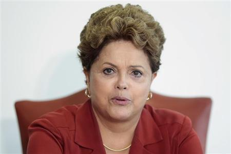 Brazil's President Rousseff reacts during a meeting with Renschler, head of production and procurement at Mercedes-Benz Cars, in Brasilia