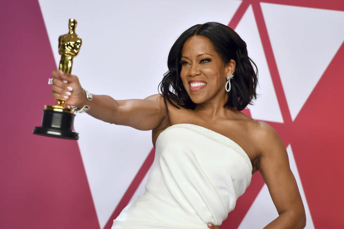 """FILE - Regina King poses with the award for best performance by an actress in a supporting role for """"If Beale Street Could Talk"""" in the press room at the Oscars on Feb. 24, 2019, in Los Angeles. King turns 50 on Jan. 15. (Photo by Jordan Strauss/Invision/AP, File)"""