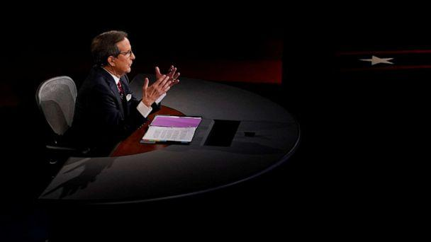PHOTO: Debate moderator and Fox News anchor Chris Wallace directs the first 2020 presidential campaign debate between U.S. President Donald Trump and Democratic presidential nominee Joe Biden in Cleveland, Sept. 29, 2020. (Morry Gash/Pool via Reuters)