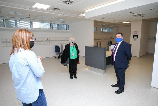 Robin Swann visiting a mass vaccination facility at the Ulster Hospital