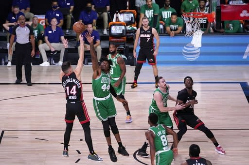 Miami Heat guard Tyler Herro (14) takes a shot over Boston Celtics' Robert Williams III (44) during the first half of Game 4 of an NBA basketball Eastern Conference final, Wednesday, Sept. 23, 2020, in Lake Buena Vista, Fla. (AP Photo/Mark J. Terrill)