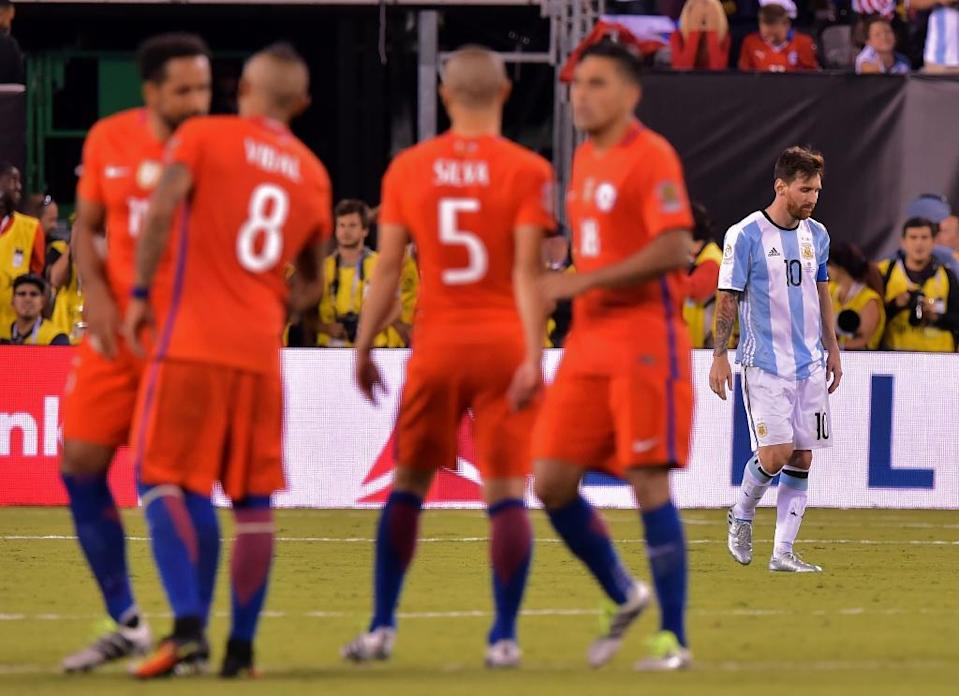 Argentina's Lionel Messi (R) reacts after missing his shot during the penalty shoot-out against Chile, during their Copa America Centenario final in East Rutherford, New Jersey, on June 26, 2016 (AFP Photo/Nicholas Kamm )