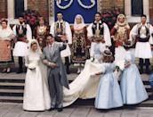 <p>Surrounded by traditional Greek dancers, Marie Chantal Miller and the exiled Crown Prince of Greece, Prince Pavlos, exit a London church after their wedding ceremony. Miller, the daughter of American businessman, Robert Miller, wore a silk and Chantilly lace wedding dress designed by Valentino. </p>