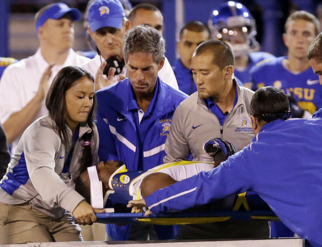 San Jose State cornerback Bene Benwikere, bottom, is carted off the field after an injury against Utah State during the second half of an NCAA college football game on Friday, Sept. 27, 2013, in San Jose, Calif. (AP Photo/Marcio Jose Sanchez)