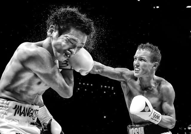 Josh Warrington lands a heavy blow on Hisashi Amagasa in April 2016. Englishman Warrington retained his WBC International featherweight title with victory over the Japanese fighter in Leeds after being awarded a unanimous points decision (Simon Cooper/PA)
