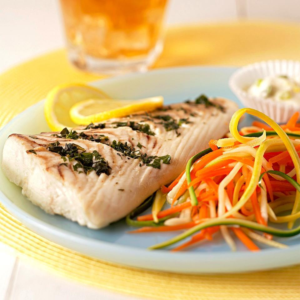 "<p>This quick-and-easy dinner recipe is ready in just 25 minutes and is sure to leave your taste buds satisfied. <a href=""http://www.eatingwell.com/recipe/264331/herbed-fish-and-vegetables-with-lemon-mayo/"" rel=""nofollow noopener"" target=""_blank"" data-ylk=""slk:View recipe"" class=""link rapid-noclick-resp""> View recipe </a></p>"