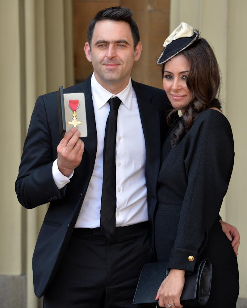 Ronnie O'Sullivan with his partner, Laila Rouass, after receiving an OBE in 2016.