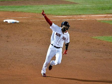 Oct 23, 2018; Boston, MA, USA; Boston Red Sox pinch hitter Eduardo Nunez (36) celebrates after hitting a three run home run against the Los Angeles Dodgers during the seventh inning in game one of the 2018 World Series at Fenway Park. David Butler II-USA TODAY Sports