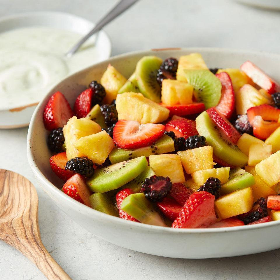 """<p>This refreshing fruit salad is a classic combination that will be the favorite at any potluck or cookout. Serve with a creamy yogurt dressing to take this side (or dessert) to the next level. <a href=""""http://www.eatingwell.com/recipe/258256/fresh-fruit-salad/"""" rel=""""nofollow noopener"""" target=""""_blank"""" data-ylk=""""slk:View recipe"""" class=""""link rapid-noclick-resp""""> View recipe </a></p>"""