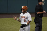 Texas' Camryn Williams (55) reacts after scoring against South Florida during the third inning of an NCAA Super Regional college baseball game, Sunday, June 13, 2021, in Austin, Texas. (AP Photo/Eric Gay)