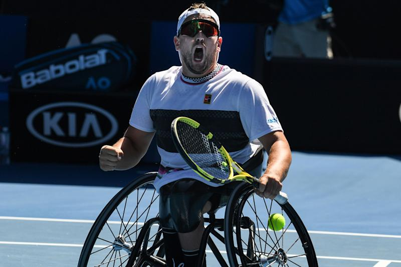 Australia's Dylan Alcott celebrates his victory against David Wagner of the US during the men's quad wheelchair singles final on day 13 of the Australian Open tennis tournament in Melbourne on January 26, 2019. (Photo by Greg Wood / AFP) / -- IMAGE RESTRICTED TO EDITORIAL USE - STRICTLY NO COMMERCIAL USE -- (Photo credit should read GREG WOOD/AFP via Getty Images)