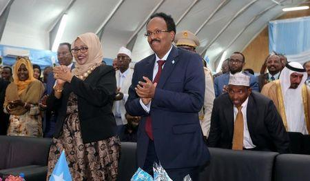Somalia's newly elected President Mohamed Abdullahi Farmaajo and his wife Zeinab Abdi applaud during his inauguration ceremony in Somalia's capital Mogadishu