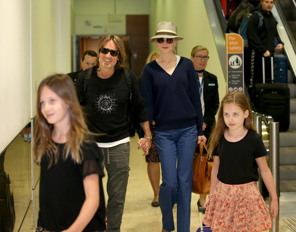 JULY 13, 2019: SYDNEY, NSW - (EUROPE AND AUSTRALASIA OUT) Nicole Kidman and Keith Urban with their daughters arrive into Sydney International Airport in Sydney, New South Wales. (Photo by Damian Shaw Photography / Newspix / Getty Images)