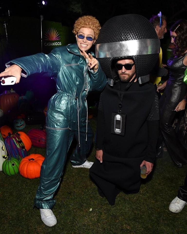 Jessica Biel dressed as NSYNC-era Justin Timberlake and Justin Timberlake dressed as a microphone at the Casamigos Halloween Party in Beverly Hills, California, October 2019.