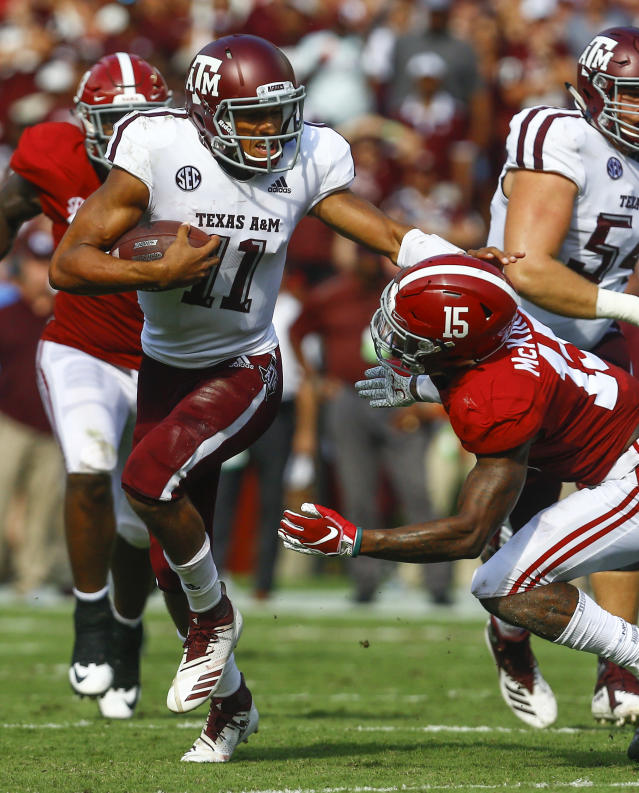 Texas A&M quarterback Kellen Mond (11) stiff arms Alabama defensive back Xavier McKinney (15) as he carries for a first down during the first half of an NCAA college football game, Saturday, Sept. 22, 2018, in Tuscaloosa, Ala. (AP Photo/Butch Dill)