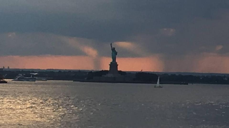 """A plaque on the Statue of Liberty features the poem """"The New Colossus"""" by Emma Lazarus: """"Send these, the homeless, tempest-tost to me."""""""