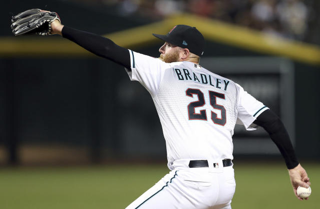 FILE - In this Sept. 7, 2018, file photo, Arizona Diamondbacks relief pitcher Archie Bradley throws to an Atlanta Braves batter during the eighth inning of a baseball game in Phoenix. The closer role is open, but Bradley is the early leader for that role. (AP Photo/Ralph Freso, File)