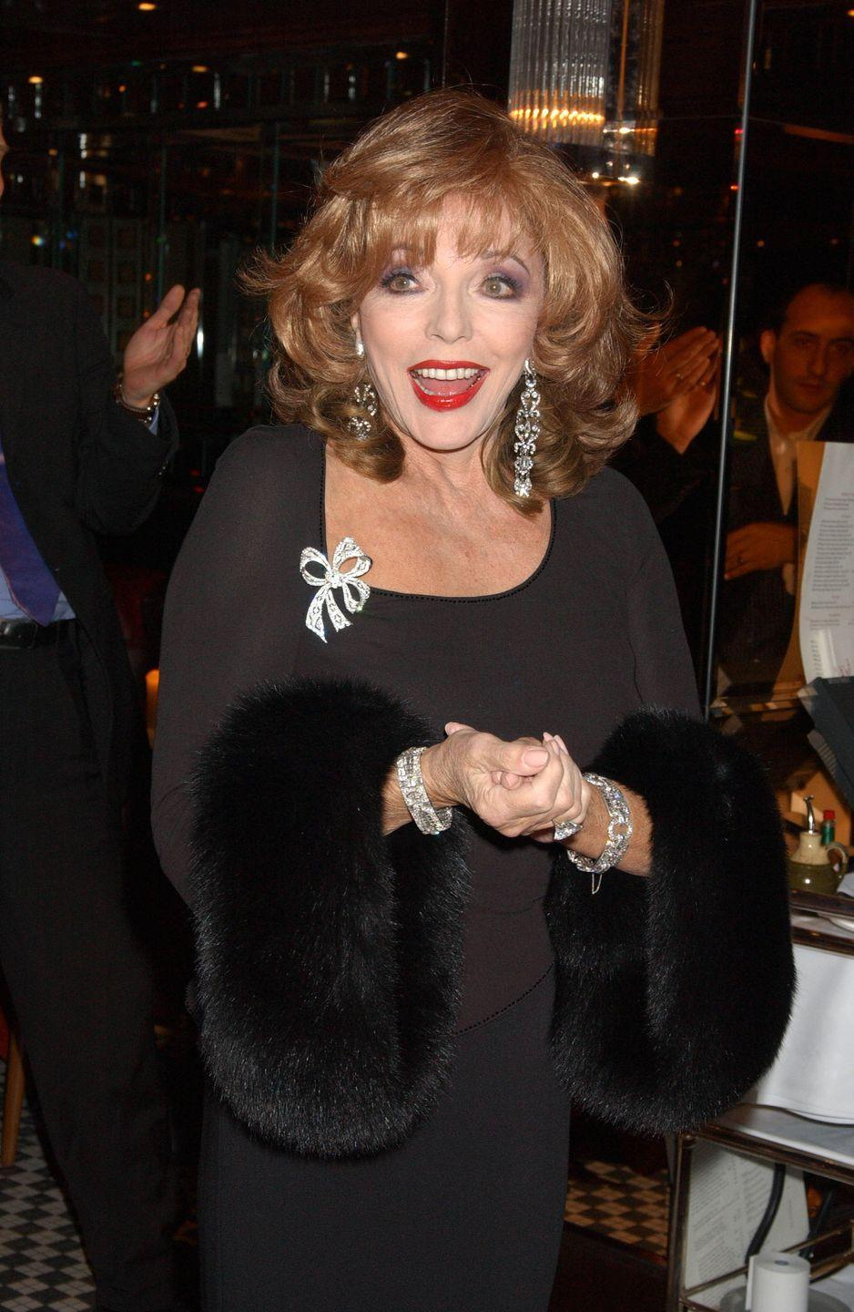 <p>Collins chose not to wear one of her signature dramatic necklaces to the launch of her book, Misfortune's Daughters, in 2004. Instead, she adorned her wrists, ears and even her dress with sparkling white diamonds. </p>