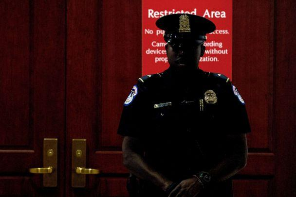 PHOTO: A Capitol Police officer stands at the entrance to a secure area during closed-door interviews with Kurt Volker, a former special envoy to Ukraine, at the Capitol in Washington, D.C., Oct. 3, 2019. (Jose Luis Magana/AP)