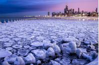 <p>The city looms in the background of this icy harbor in Chicago.</p>