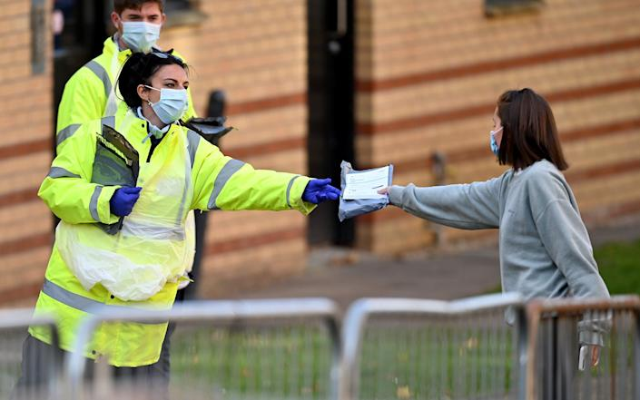 Students from Glasgow University attend a pop-up coronavirus testing centre at Murano Street Student Village - Jeff J Mitchell/Getty