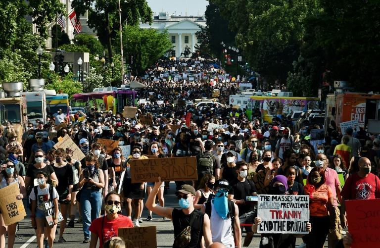Protesters march near the White House on June 6, 2020