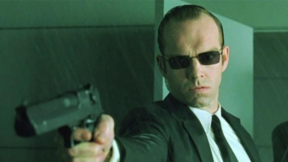 Hugo Weaving as Agent Smith in 'The Matrix'. (Credit: Warner Bros)