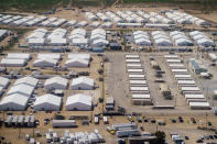 Tents are set up at Fort Bliss' Doña Ana Village, in New Mexico, where Afghan refugees are being housed, Friday, Sept. 10, 2021. The Biden administration provided the first public look inside the U.S. military base where Afghans airlifted out of Afghanistan are screened, amid questions about how the government is caring for the refugees and vetting them. (AP Photo/David Goldman)