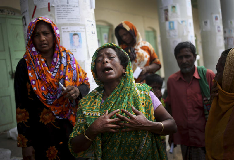 A woman grieves for her late relative after his body was pulled from the rubble in the collapsed garment factory building and brought to the morgue, in Savar, near Dhaka, Bangladesh, Saturday, May 4, 2013. In the aftermath of a building collapse that killed more than 530 people, Bangladesh's garment manufacturers may face a choice of reform or perish. (AP Photo/Wong Maye-E)