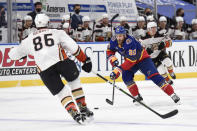 Anaheim Ducks' Simon Benoit (86) defends against St. Louis Blues' Ryan O'Reilly (90) during the second period of an NHL hockey game on Wednesday, May 5, 2021, in St. Louis. (AP Photo/Joe Puetz)