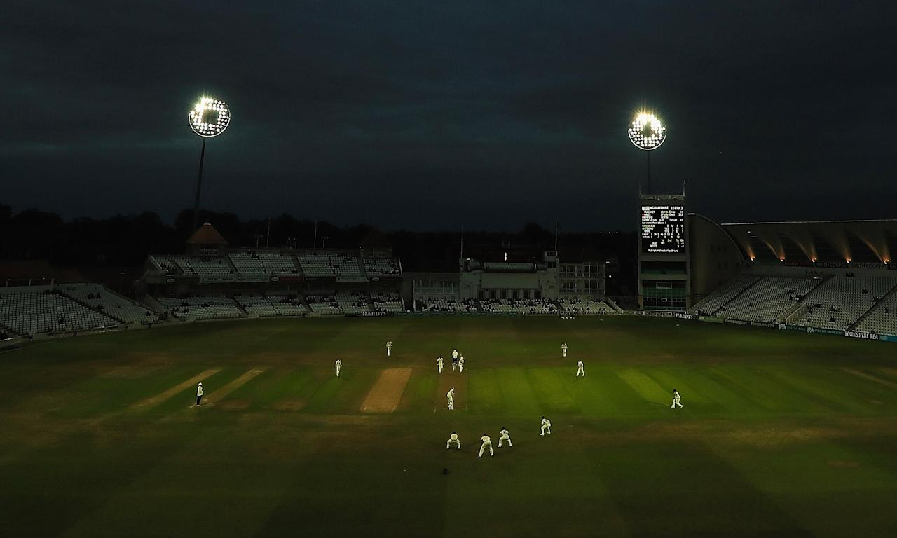Darkness descends on Trent Bridge but the cricket continues in a scene replicated across the County Championship on Monday.