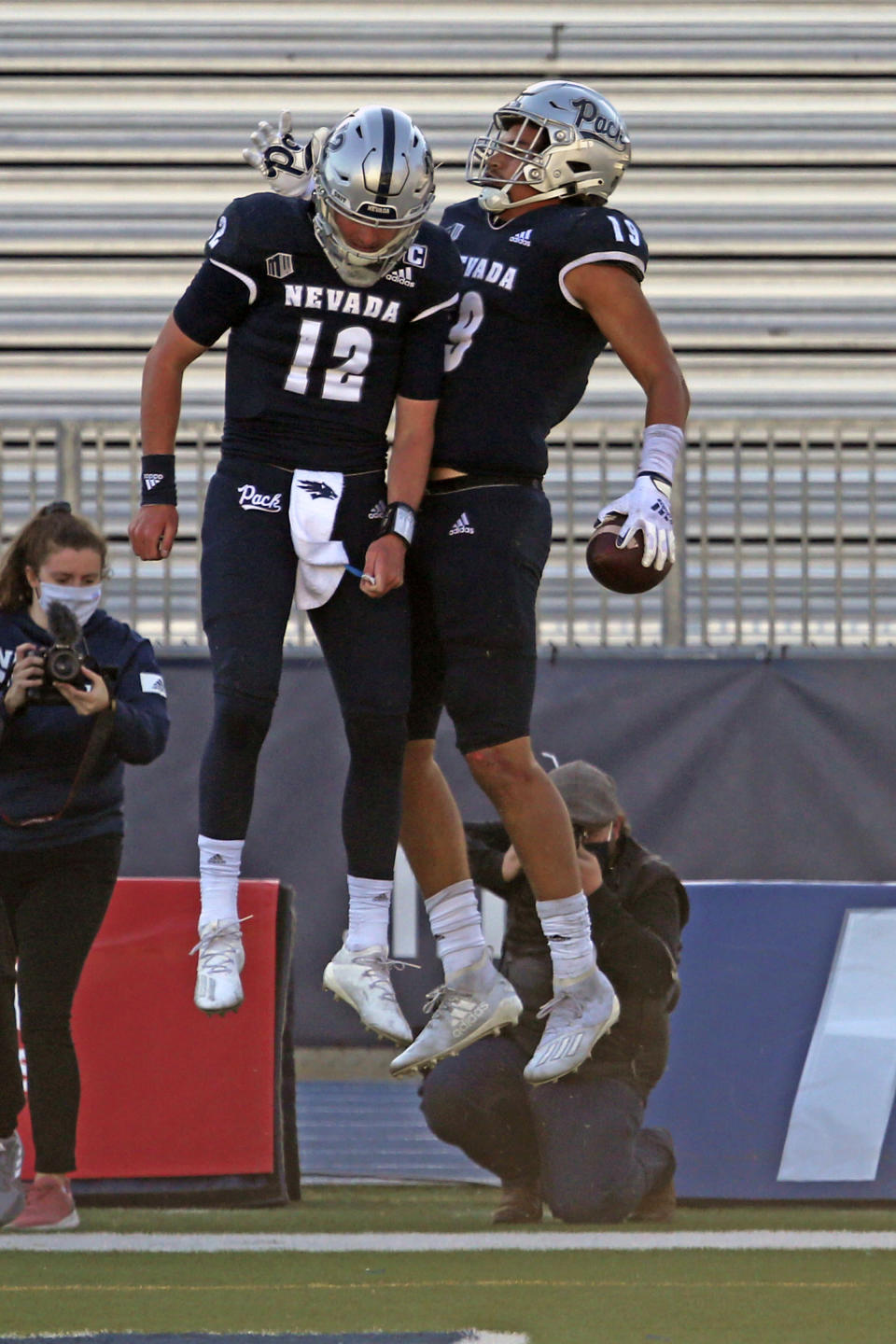 Nevada quarterback Carson Strong (12) celebrates with wide receiver Cole Turner after a touchdown pass against San Diego State during an NCAA college football game Saturday, Nov. 21, 2020, in Reno, Nev. (AP Photo/Lance Iversen)