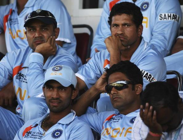 PORT OF SPAIN, TRINIDAD AND TOBAGO - MARCH 23:  Sachin Tendulkar and Virender Sehwag of India look on dejected as India lose the ICC Cricket World Cup 2007 Group B match between India and Sri lanka at the Queens Park Oval Cricket Ground on March 23, 2007 in Port of Spain, Trinidad.  (Photo by Clive Rose/Getty Images)