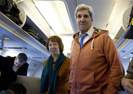 U.S. Secretary of State John Kerry and EU foreign policy chief Catherine Ashton visit the media seating area of Kerry's aircraft as it sits on the tarmac at Geneva International airport, before leaving for London, November 24, 2013. REUTERS/Carolyn Kaster/Pool
